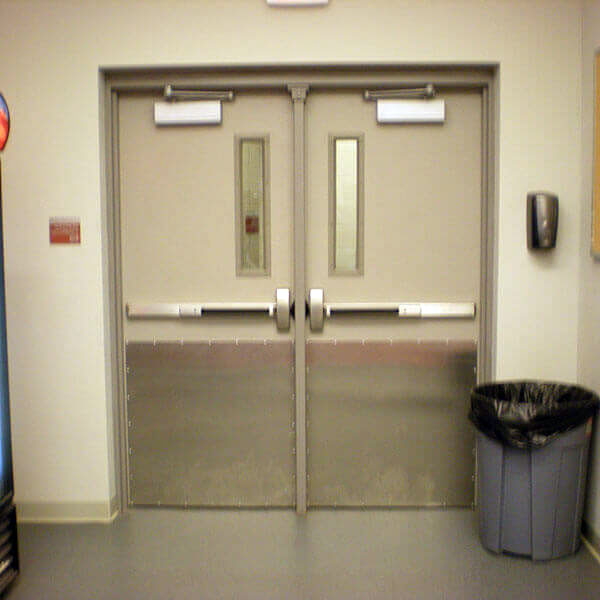 Hollow Metal Double Doors with Rim Exit Devices and Mullion